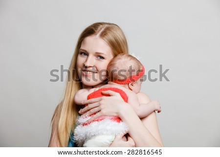 Mother and newborn daughter - stock photo