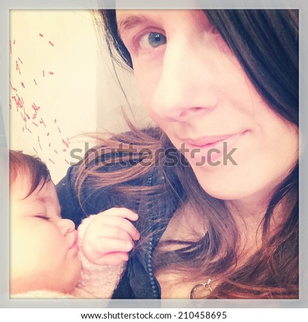 Mother and Sleeping baby - with soft grainy Instagram effect - stock photo