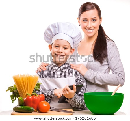 mother and som are cooking on the kitchen - stock photo
