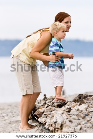 Mother and son at beach - stock photo