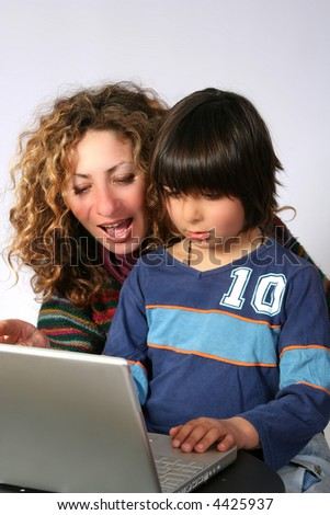 Mother and son at computer - stock photo