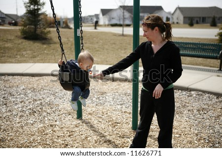 Mother and son at neighborhood park - stock photo