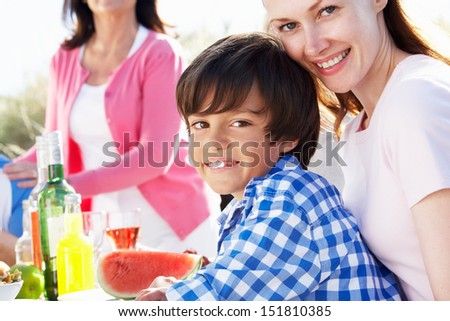 Mother And Son At Outdoor Barbeque - stock photo