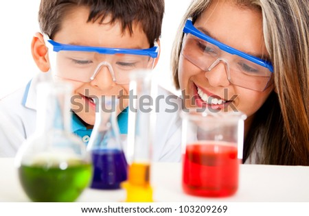 Mother and son at the lab playing scientist - isolated over white - stock photo