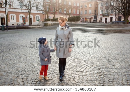 Mother and son at the old European city - stock photo