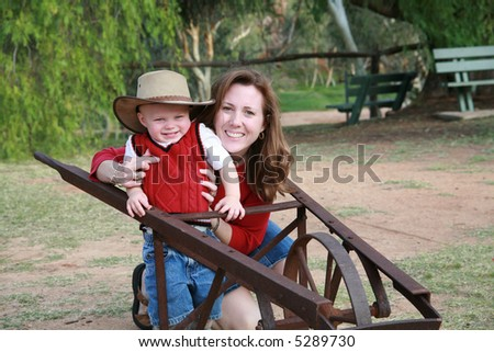 Mother and son at the ranch. - stock photo