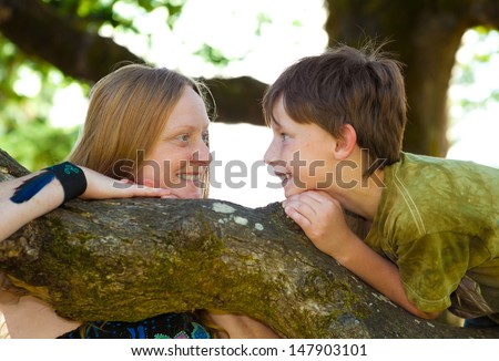 Mother and son brainstorming wild ideas - stock photo
