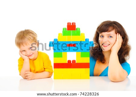 Mother and son building home - stock photo