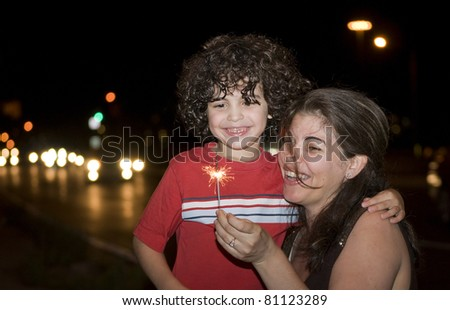 Mother and Son celebrate the anniversary of the city they currently live in - stock photo
