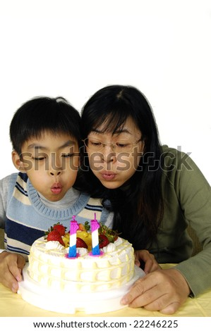 Mother and son celebrating a birthday - stock photo