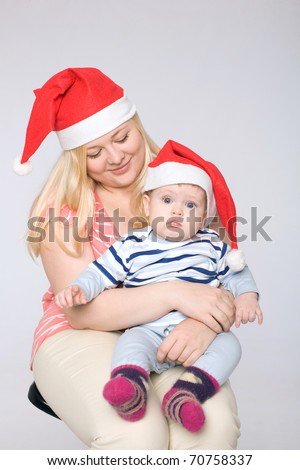 Mother and son celebrating New Year - stock photo