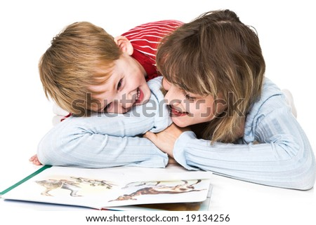 Mother and son cheerfully read the book - stock photo