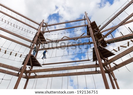 Mother and son conquering an obstacle course - stock photo
