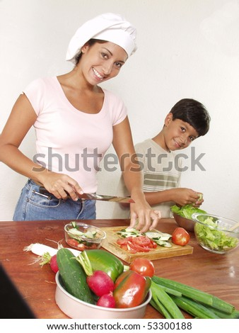 Mother and son cooking. - stock photo