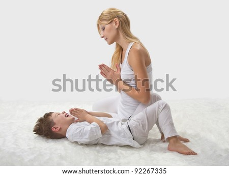 Mother and son do yoga before bed - stock photo
