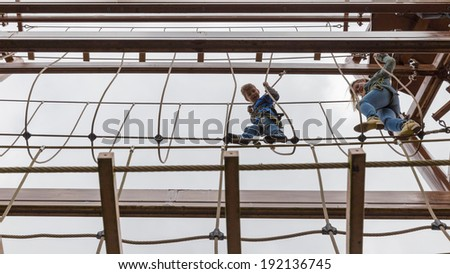 Mother and son doing an obstacle course - stock photo