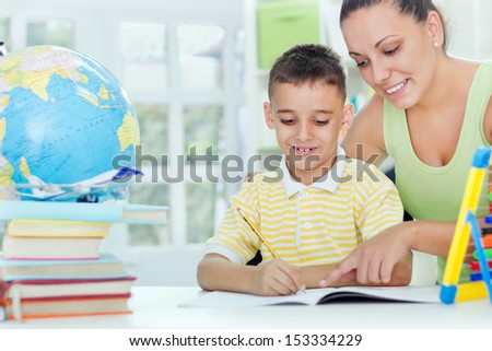 mother and son doing homework - stock photo