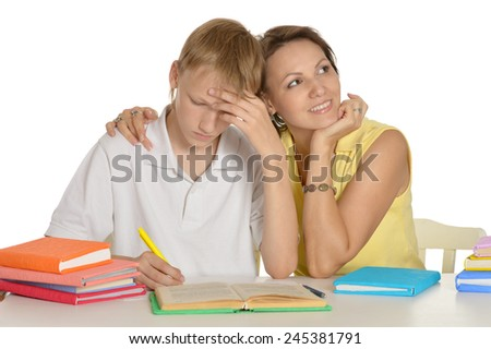 Mother and son doing homework together