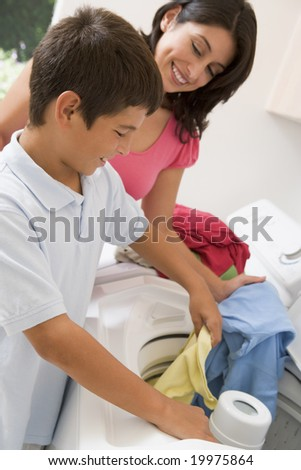 Mother And Son Doing Laundry - stock photo