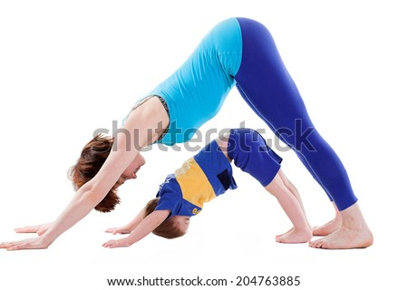 mother and son doing yoga. isolated on white  - stock photo