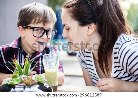 Mother and son drinking juice. Shallow depth of field  - stock photo