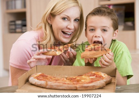 Mother And Son Eating Pizza Together - stock photo