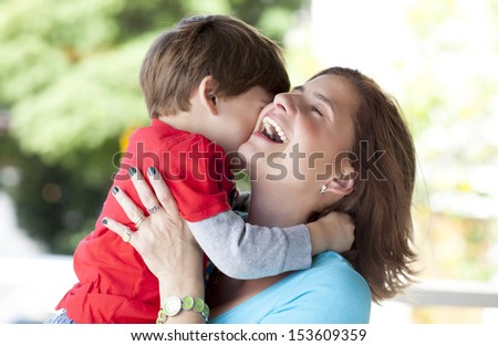 mother and son embraced - stock photo