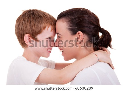 mother and son embracing cheek to cheek , isolated on white background, studio shot