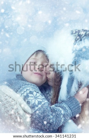 Mother and son enjoying beautiful winter day outdoors - stock photo