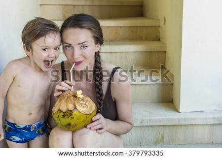 Mother and son enjoying their holiday together - stock photo