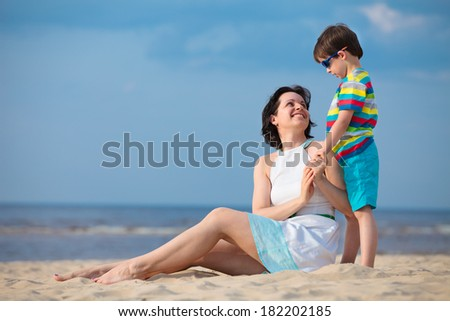 Mother and son enjoying time at tropical beach