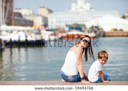 Mother and son enjoying views of city center Helsinki Finland - stock photo