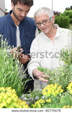 Mother and son gardening - stock photo