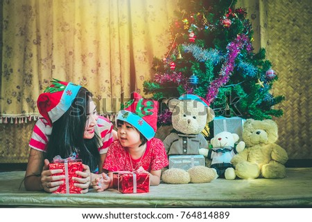 mother and son happy for Christmas gifts in the Christmas festival.New year celebration concept.