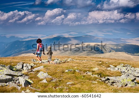 Mother and son having a great time together, traveling in the mountains - stock photo
