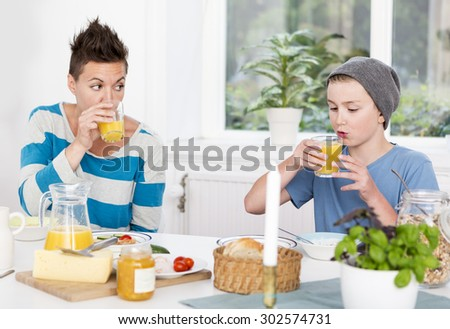 Mother and son having breakfast together in the morning