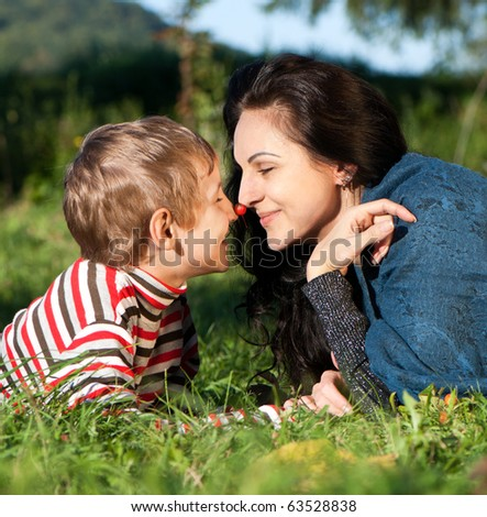 Mother and Son Having Fun in park - stock photo