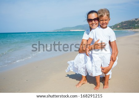Mother and son having fun on tropical beach