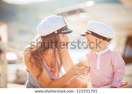 Mother and Son Having Fun outdoor on the sea pier - stock photo