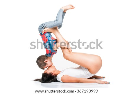 Mother and son having fun practicing yoga together - stock photo