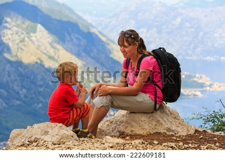 mother and son having rest on vacation in mountains - stock photo
