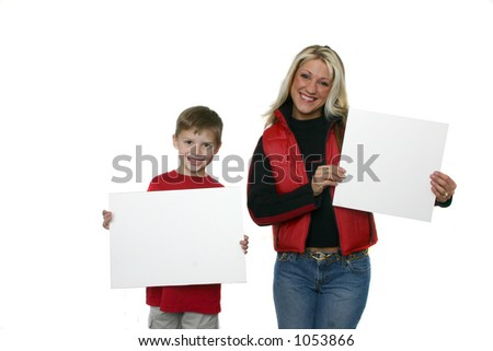 Mother and son holding blank signs