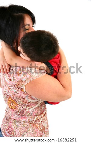 Mother and son hugging over white background.
