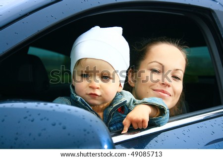 mother and son in a new car - stock photo