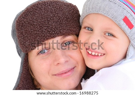 Mother and son in caps - autumnal portrait - stock photo