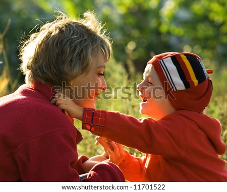 Mother and son in park - stock photo