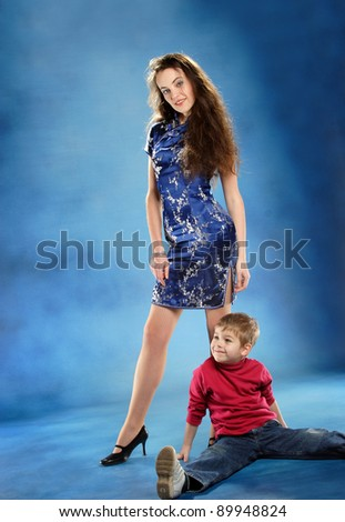 Mother and son in the artistic photo shoots - stock photo