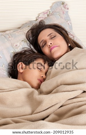 Mother and son in the bed . - stock photo