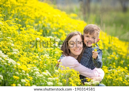 Mother and son in the park. soft daylight - stock photo