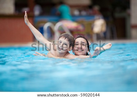 mother and son in the swimming pool - stock photo